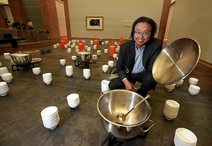 Thai conceptual and installation artist residing in New York, Berlin, and Chiang Mai. He was born in Argentina in 1961. Tiravanija's practice often involves everyday actions and commonplace materials, as well as audience interaction. His first untitled solo show, at 303 Gallery, New York in 1992, consisted of offering visitors Thai food cooked on-site. His installations often take the form of stages or rooms for sharing meals, cooking, reading or playing music; architecture or structures for living and socializing are a core element in his work.