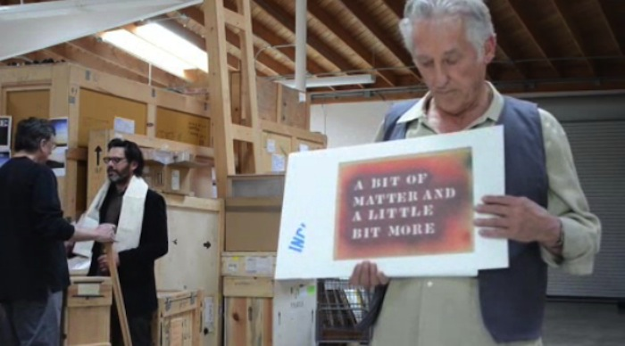 "Ed Ruscha honors his friend and fellow artist Lawrence Weiner. He created a three-minute tribute in the form of a parody of Bob Dylan's legendary music video for ""Subterranean Homesick Blues"" with placards featuring Weiner text pieces. The mash-up soundtrack is sung by Ruscha himself. See it here."