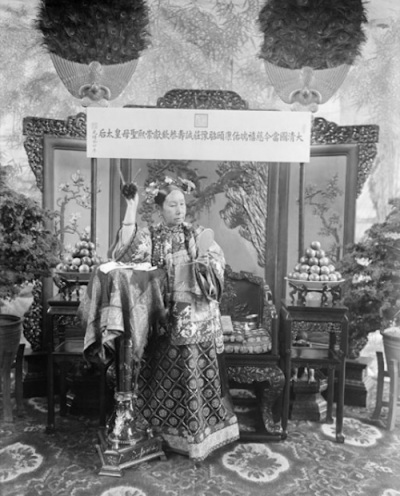 'The Empress Dowager Cixi gazing at a hand mirror', 1903. Xunling. Black and white photograph. Freer Gallery of Art and Arthur M. Sackler Gallery, Smithsonian Institution, Washington, DC